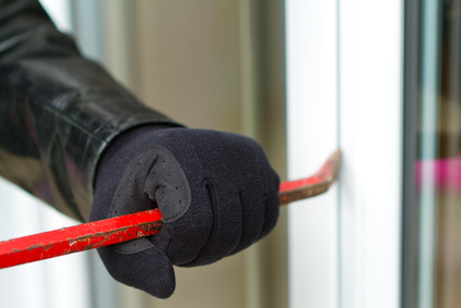 Burglar breaking in a house